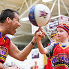 "Harlem Wizards player ""Blackjack"" helps Brennan Oldham to spin a basketball on his finger at the close of the Wizards' game against Abington School District faculty and administrators at Abington High School April 8.  Rachel Wisniewski — For Digital First Media"