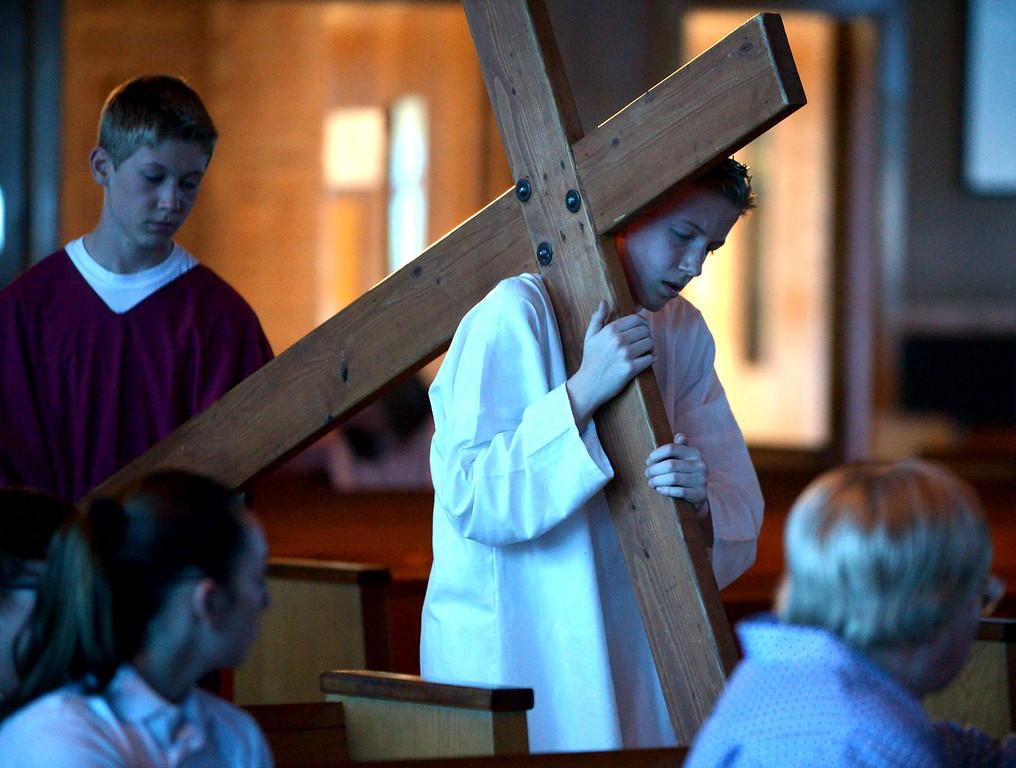 . Simon of Cyrene helps Jesus carry his cross during the re-enactment of the passion and death of Jesus at St. Stanislaus Catholic Church April 12, 2017.(Bob Raines / Digital First Media)