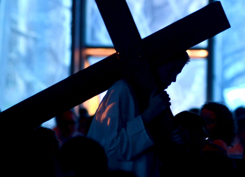 . Jesus and his cross are silhouetted against the windows St. Stanislaus Catholic Church April 12, 2017.  (Bob Raines / Digital First Media)