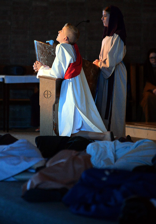 . Jesus prays in the Garden of Gesthemane as his disciples sleep on the night before his trial and crucifixion during the seventh grade re-enactment of the Passion of Christ at St. Stanislaus Catholic Church April 12, 2017.  (Bob Raines / Digital First Media)