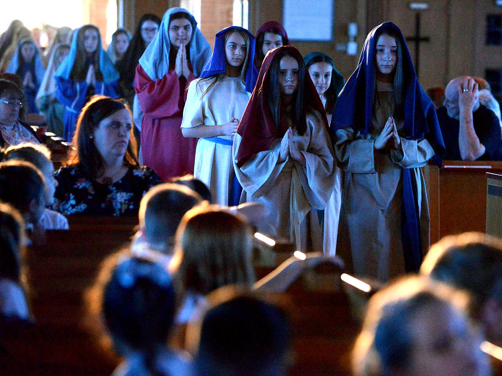 . The seventh grade players enter the St. Stanislaus Catholic Church sanctuary to re-enact the Passion of Christ April 12, 2017.  (Bob Raines / Digital First Media)