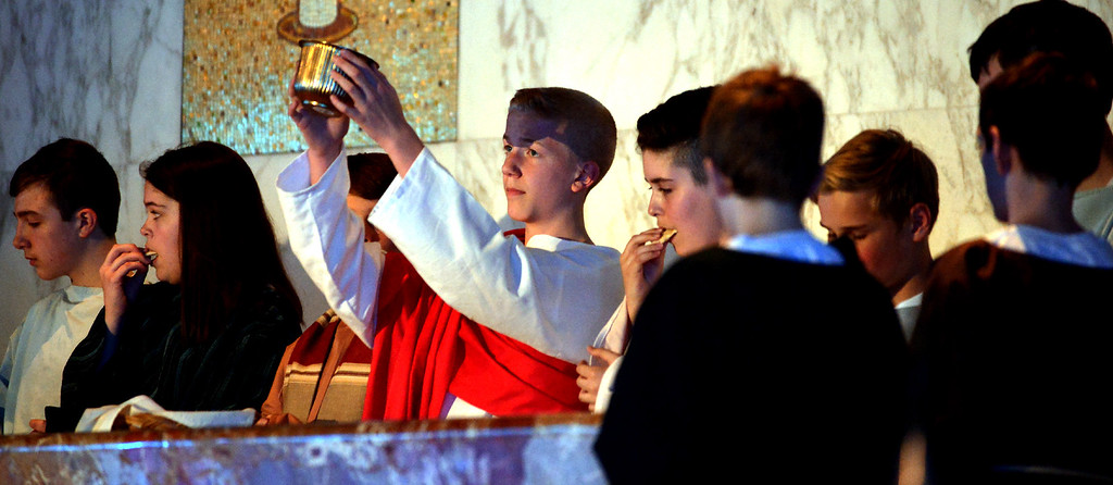 . Jesus blesses the wine at the Last Supper as seventh grade students  re-enact the Passion of Christ at St. Stanislaus Catholic Church April 12, 2017.  (Bob Raines / Digital First Media)