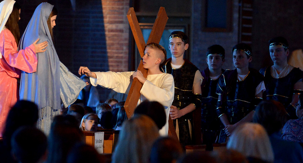 . Jesus reaches out to his mother, Mary, drags his cross through Jerusalem on his way to Calvary during the  re-enactment of Christ\'s Passion at St. Stanislaus Catholic Church April 12, 2017.  (Bob Raines / Digital First Media)