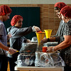 Students Vincent Sordini and Skylar Dingaro and teachers Terri Noble and Phyllis Watto assemble meal pouches for Pennridge FISH April 18, 2017.  (Bob Raines / Digital First Media)