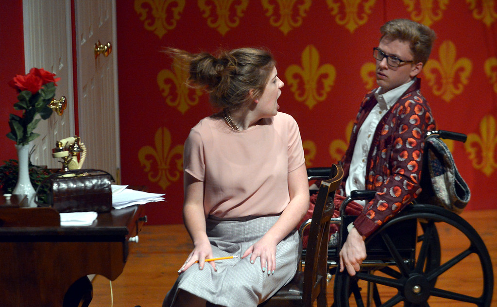 . Sheridan Whiteside (Isaac Longacre) unsuccessfully tries to persuade his secretary, Maggie Cutler (Haley Mong), to continue working for him and not stay in Ohio to be with the local newsman.  (Bob Raines/Digital First Media)