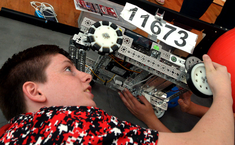 Eighth-grader AJ Larson looks at the underside of a robot searching for the cause of a drive mechanism problem during the Hatboro-Horsham School District Robotics Expo at Hallowell Elementary School May 2, 2017.  (Bob Raines/Digital First Media)
