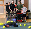 Members of the high school robotics team direct their machine around the floor to collect plastic balls before shooting them into a raised hopper during the Hatboro-Horsham School District Robotics Expo at Hallowell Elementary School May 2, 2017.  (Bob Raines/Digital First Media)
