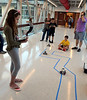 Hallowell fourth-grader Addison Hornby, left, watches her robot navigate a slalom course noting the programming corrections she needs to make as she participates in the Hatboro-Horsham School District Robotics Expo at Hallowell Elementary School May 2, 2017.  (Bob Raines/Digital First Media)