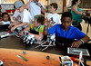 Amir Crews, right, adjusts the parameters for his robot in the computer controller as students Ben Koebert and Timmy James, Jr., left, deal with mechanical adjustments during the Hatboro-Horsham School District Robotics Expo at Hallowell Elementary School May 2, 2017. All attend Crooked Billet Elementary School  (Bob Raines/Digital First Media)