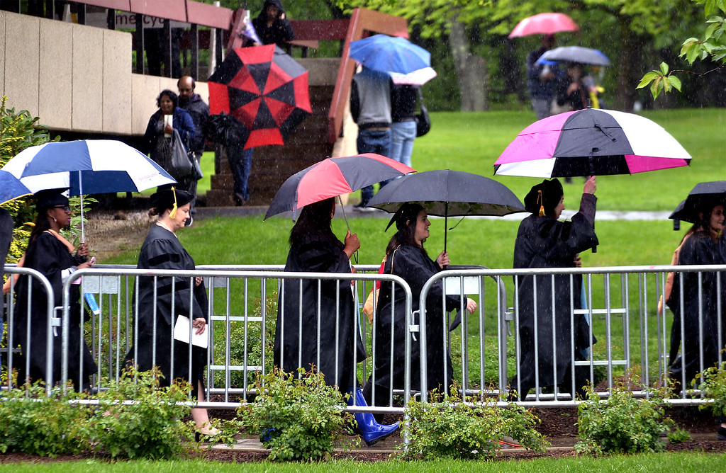 . Umbrellas blossom as the student procession leaves the Griffin Complex for the Gwynedd Mercy University commencement May 13, 2017.  (Bob Raines/Digital First Media)