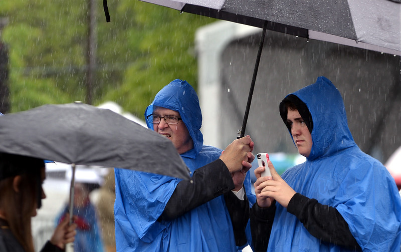 A father and son wait for the chance to get a photo of a graduating Gwynedd Mercy University student May 13, 2017.  (Bob Raines/Digital First Media)