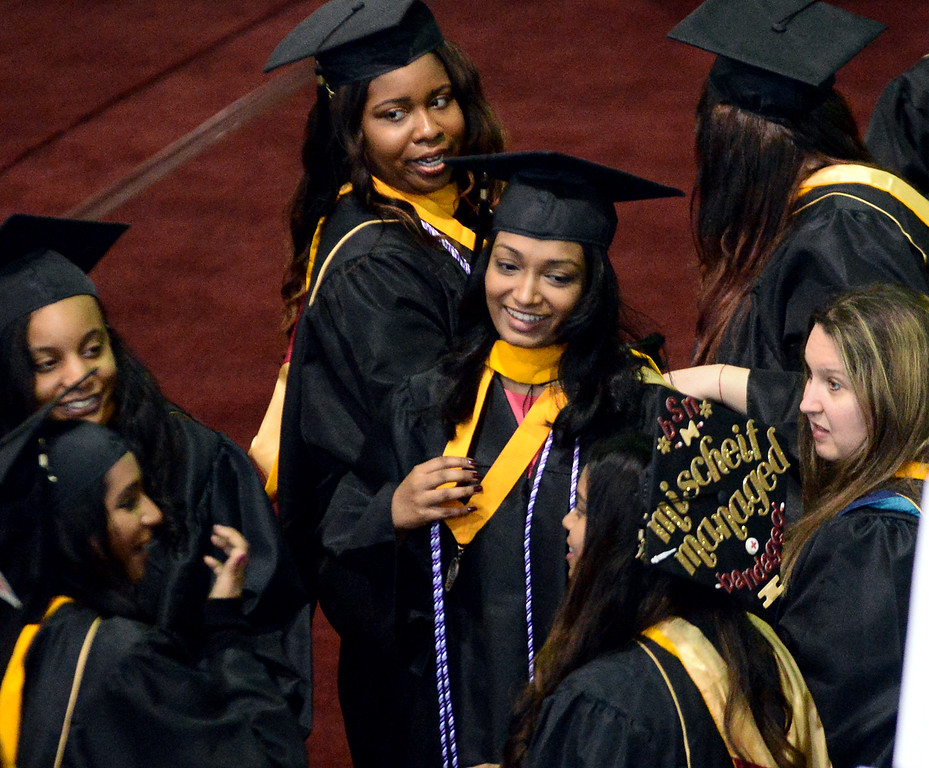 . Classmates talk together as they line up for the Gwynedd Mercy University commencement May 13, 2017.  (Bob Raines/Digital First Media)