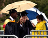 Students share an umbrella during the procession at the Gwynedd Mercy University commencement May 13, 2017.  (Bob Raines/Digital First Media)