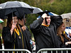 A student straightens his hat during the procession at the Gwynedd Mercy University commencement May 13, 2017.  (Bob Raines/Digital First Media)