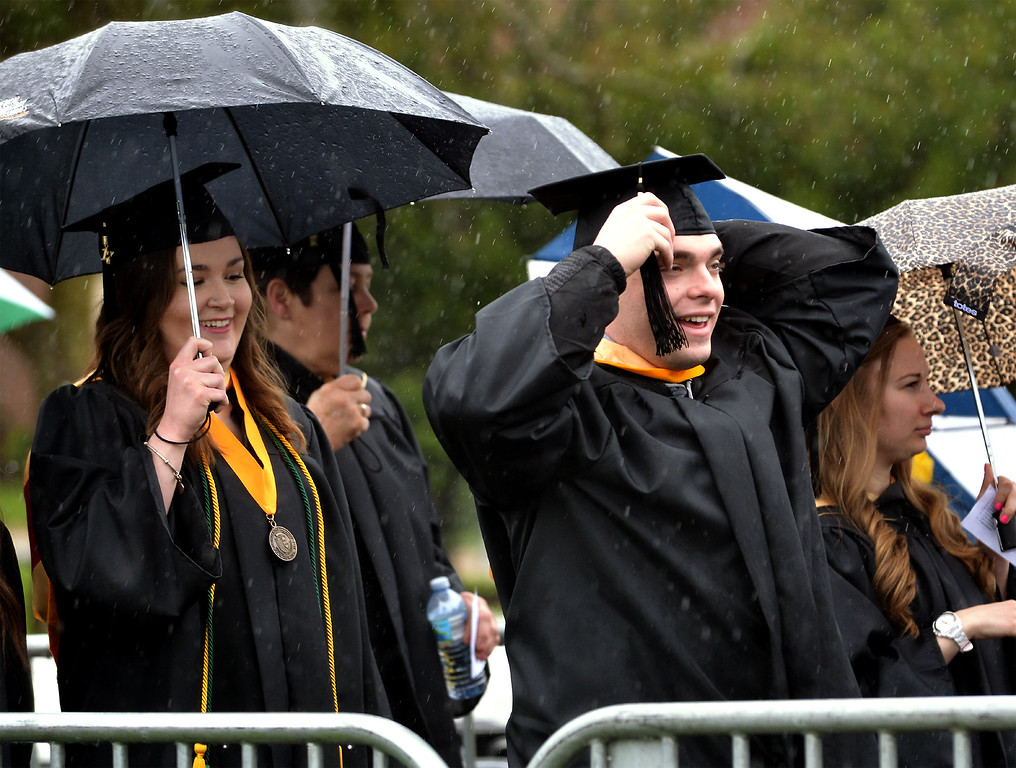 . A student straightens his hat during the procession at the Gwynedd Mercy University commencement May 13, 2017.  (Bob Raines/Digital First Media)