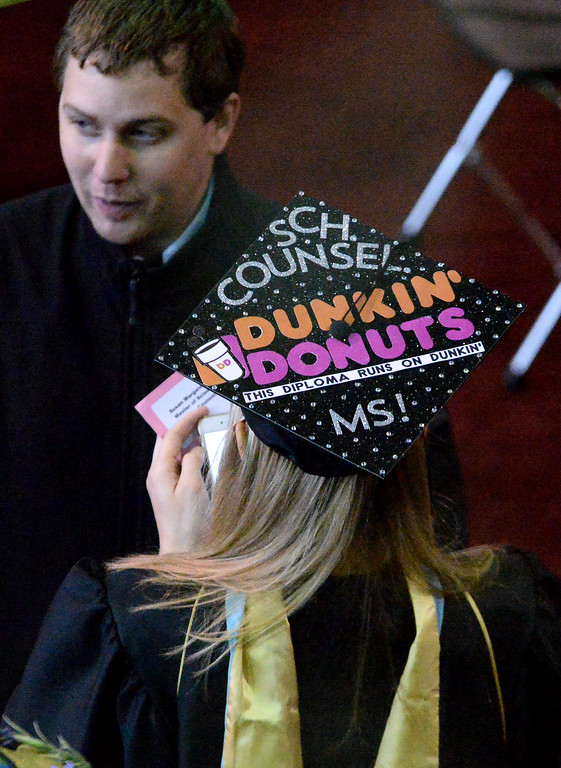 ". One student decorated her hat with a Dunkin\' Donuts theme. The small print says, ""This diploma runs on Dunkin,\"" May 13, 2017.  (Bob Raines/Digital First Media)"