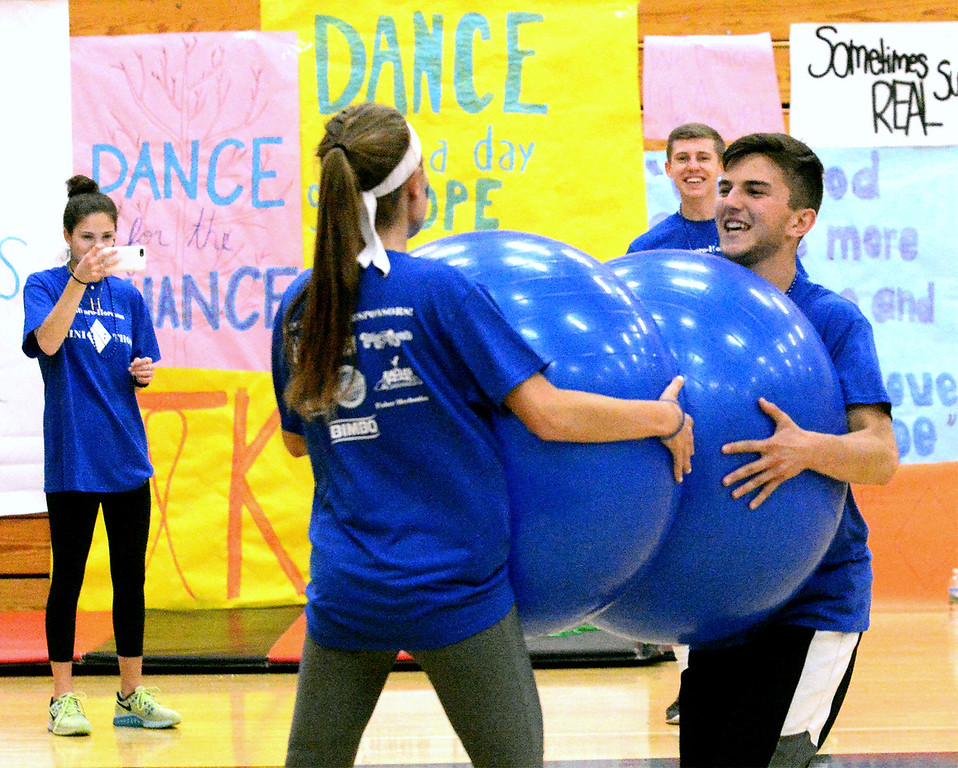 . Two students belly bump with exercise balls at the Hatboro-Horsham High School miniTHON May 13, 2017.  (Bob Raines/Digital First Media)