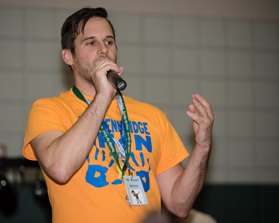 . Adviser David Brown speaks to the crowd, getting them energized during Pennridge High School�s Mini-THON Saturday, May 13.  Jeff Davis � For Digital First Media