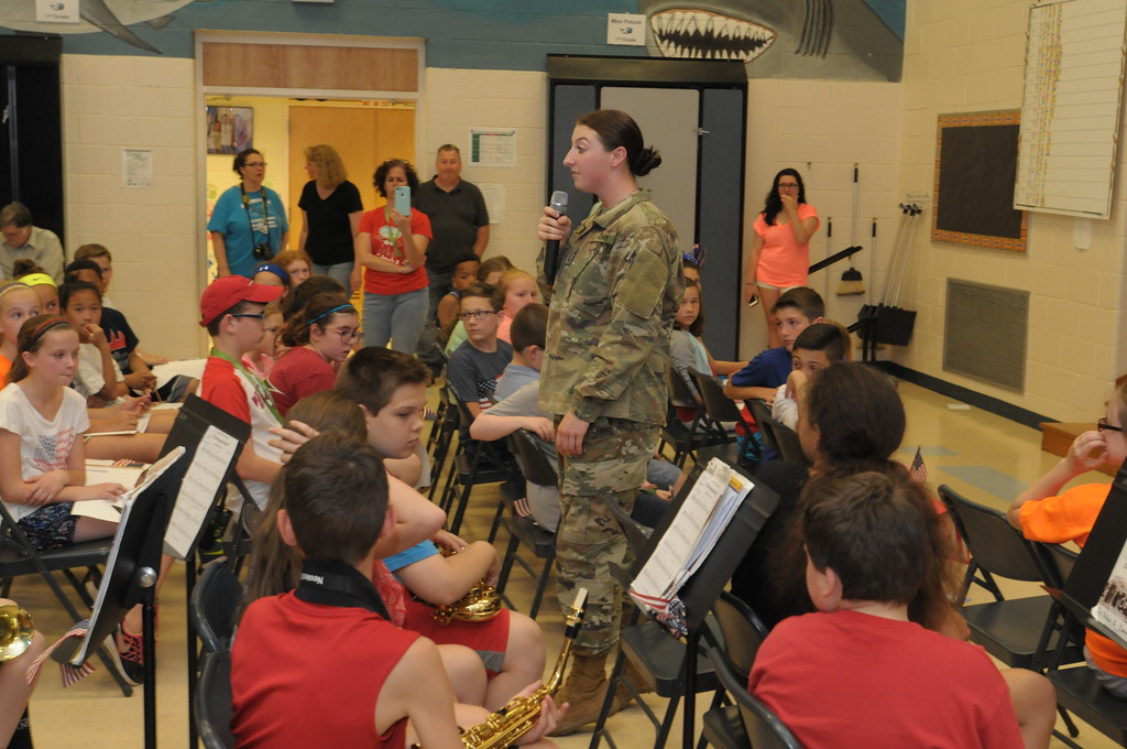 . Alice Murphy, a Pennridge High School graduate and Army National Guard member surprises her brother at Sellersville Elementary while home from basic training May 19, 2017. Gene Walsh � Digital First Media