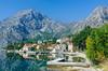 The village of Orahovac reflected in Lake Kotor, Montenegro.