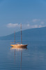 A lone sailboat relfected in the calm waters of the Bay of Kotor, Montenegro.