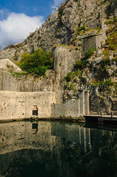 The medieval walled village of Kotor and the fortress on the Bay of Kotor, Montenegro.