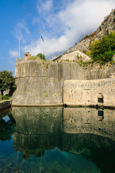 The medieval walled village of Kotor and the fortress on Bay of Kotor, Montenegro.