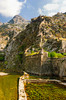 Fortresses and the medieval walled village of Kotor on the hillside above the Bay of Kotor, Montenegro.