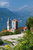 The steeple of the St. Nicholas church and the Bay of Kotor with its island churches at Perast, Montenegro.
