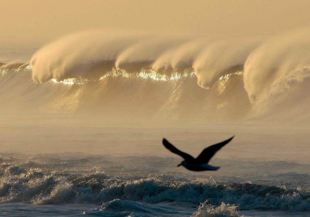 . Large waves break at Seacliff State Beach in Aptos on Saturday, December 12, 2015.  (Vern Fisher - Monterey Herald)