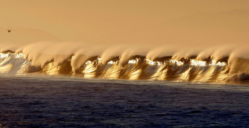. Waves break in the early morning light in Moss Landing on Jan. 10, 2012.  (Vern Fisher/Monterey Herald)