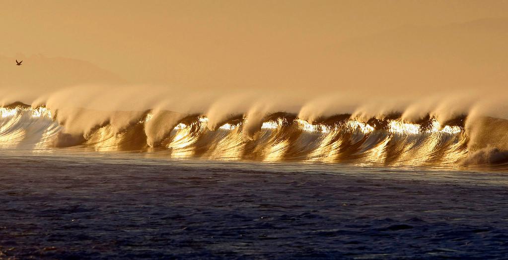 . Waves break in the early morning light in Moss Landing on Jan. 10, 2012.  (Vern Fisher/Monterey Herald)
