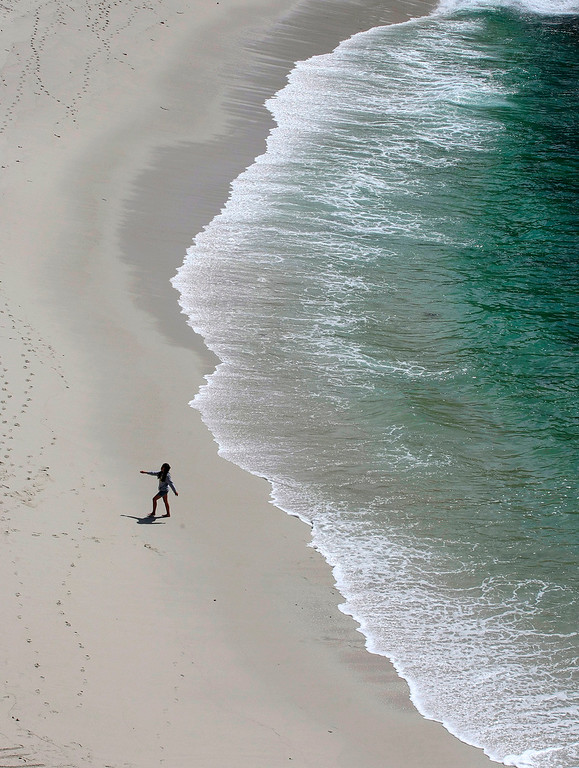 . A lone person walks the shore at Gibson Beach in Point Lobos State Natural Reserve on March 18, 2015.   (Vern Fisher - Monterey Herald)