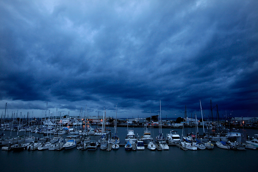 . Storm clouds over the Moss Landing Harbor on December 11, 1024. (Vern Fisher - Monterey Herald)
