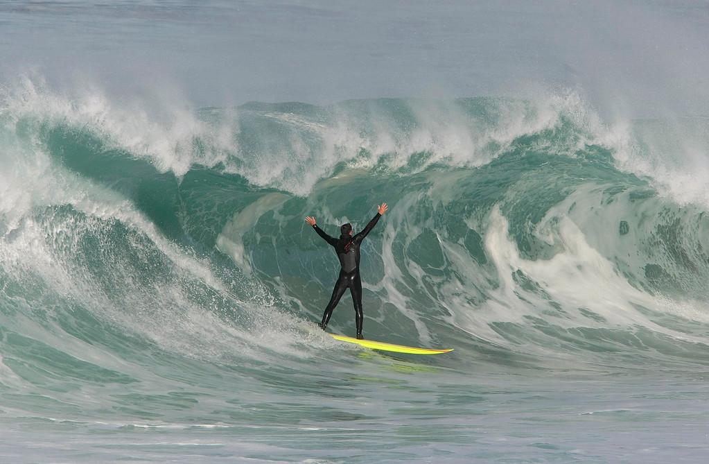 . John Pennington from Monterey enjoying the big surf on the Monterey Peninsula Monday, December 7, 2015.  (Vern Fisher - Monterey Herald)
