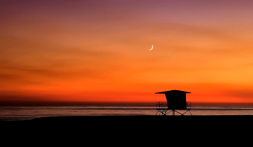 . A lifeguard tower and a setting moon over Rio Del Mar State Beach in Aptos on Nov. 11, 2002.  (Vern Fisher - Monterey Herald)