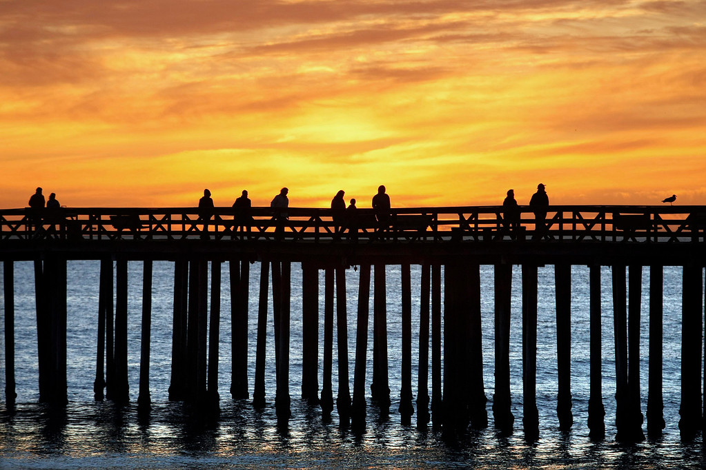 . People watch the sunset at Seacliff State Beach in Aptos on Saturday, Jan. 3, 2008.  (Vern Fisher - Monterey Herald)
