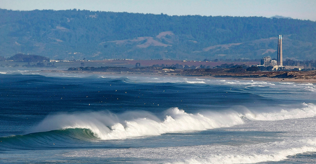. Looking north towards Moss Landing as offshore winds blow against large surf off Fort Ord Dunes State Park on Jan. 13, 2014.  (Vern Fisher - Monterey Herald)