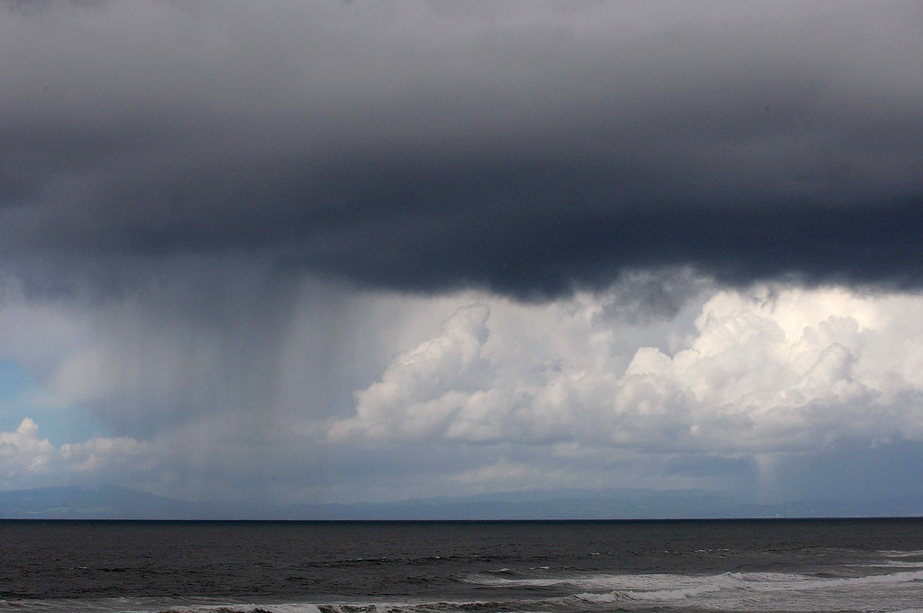 . Rain showers pass to the north of Marina State Beach on Monday, April 16, 2018.  (Vern Fisher - Monterey Herald)