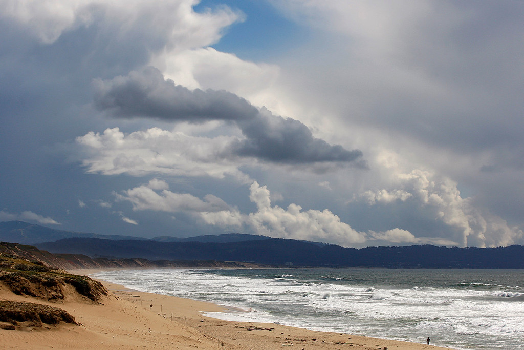 . Rain showers pass to the south of Marina State Beach on Monday, April 16, 2018.  (Vern Fisher - Monterey Herald)
