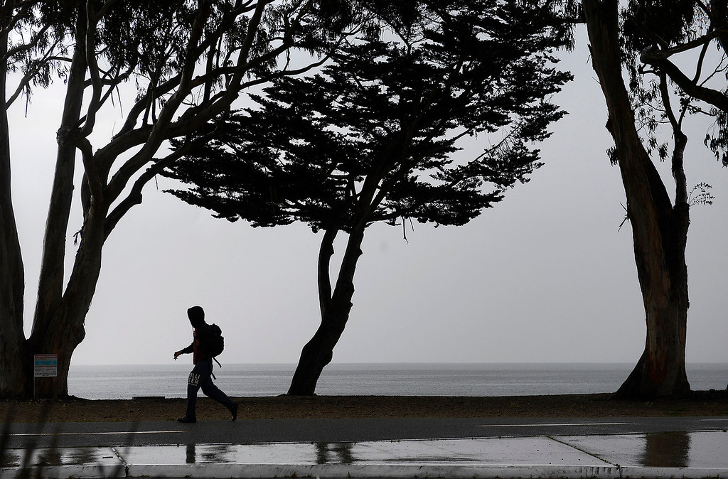 . Wind and rain arrive onshore in Monterey on Monday, April 16, 2018.  (Vern Fisher - Monterey Herald)
