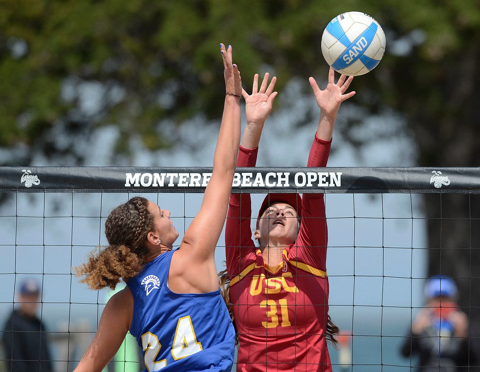 . USC\'s Jenna Belton, right, of Aptos blocks against San Jose State\'s Julia Golbeck during the second annual Monterey College Invitational beach volleyball tournament at Window on the Bay Park in Monterey on Sunday April 2, 2017. (David Royal - Monterey Herald)
