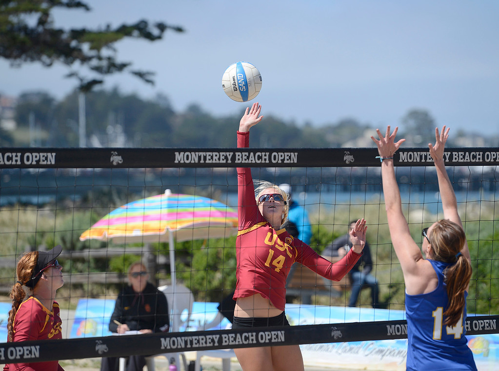 . USC\'s Sara Hughes hits the ball across the net against San Jose State\'s Alli Mehan during the number one match during the second annual Monterey College Invitational beach volleyball tournament at Window on the Bay Park in Monterey on Sunday April 2, 2017. Hughes and teammate Kelly Claes, at left, were 96-0 before winning the match. (David Royal - Monterey Herald)