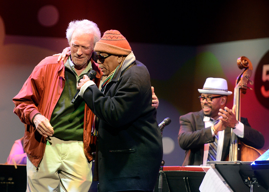 . Clint Eastwood embraces Quincy Jones as bassist Christian McBride looks on during Tribute to Quincy Jones The A&M Years at the 59th annual Monterey Jazz Festival at the Monterey County Fair and Events Center in Monterey, Calif. on Friday September 16, 2016.  (David Royal - Monterey Herald)