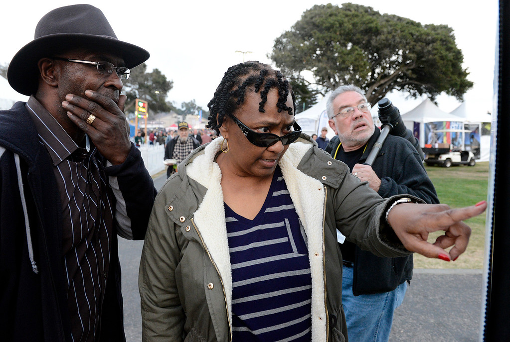 . Steven Edwards, left, and his wife Deniese both of Houston check the schedule during the 59th annual Monterey Jazz Festival at the Monterey County Fair and Events Center in Monterey, Calif. on Friday September 16, 2016.  (David Royal - Monterey Herald)