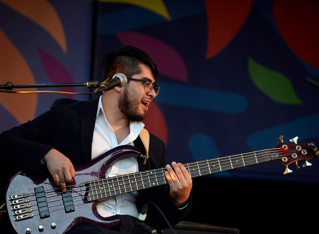 . Gerson Lazo-Quiroga plays bass with the Berklee College of Music group titled Mixcla +1 on the Garden Stage during the 59th annual Monterey Jazz Festival at the Monterey County Fair and Events Center in Monterey, Calif. on Friday September 16, 2016.  (David Royal - Monterey Herald)