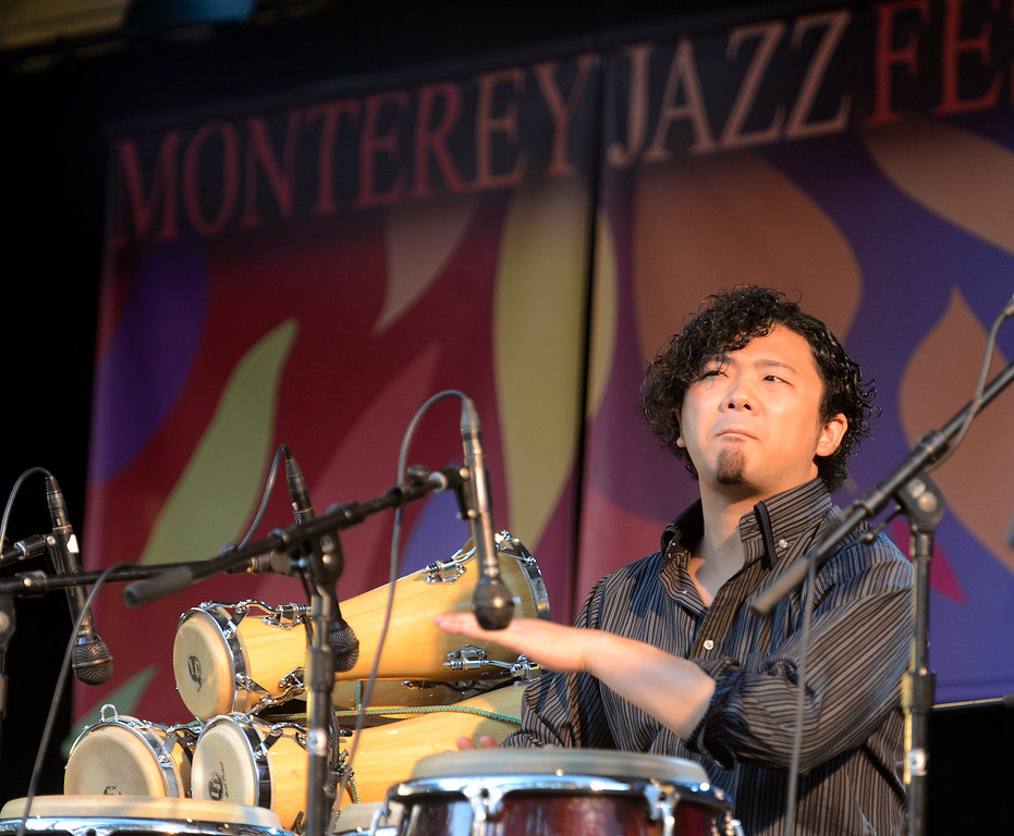 . Takafumi Nikaido plays percussion with the Berklee College of Music group titled Mixcla +1 on the Garden Stage during the 59th annual Monterey Jazz Festival at the Monterey County Fair and Events Center in Monterey, Calif. on Friday September 16, 2016.  (David Royal - Monterey Herald)