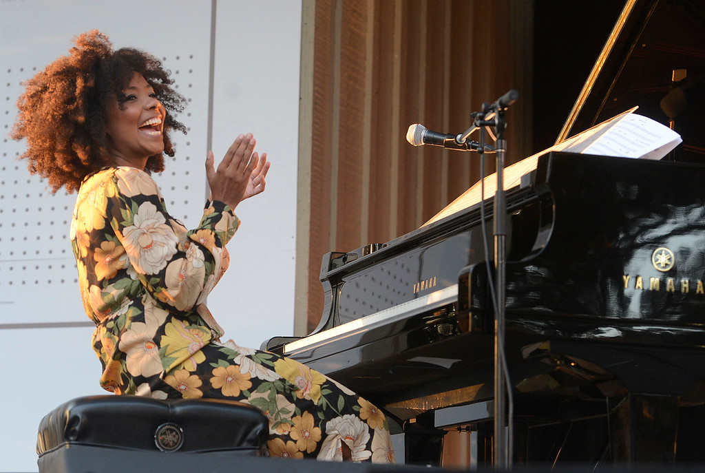 . Zahili Gonzalez Zamora applauds while singing and playing piano with the Berklee College of Music group titled Mixcla +1 on the Garden Stage during the 59th annual Monterey Jazz Festival at the Monterey County Fair and Events Center in Monterey, Calif. on Friday September 16, 2016.  (David Royal - Monterey Herald)