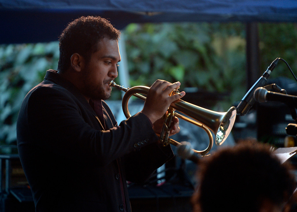. Paul Sanchez plays horn with the Berklee College of Music group titled Mixcla +1 on the Garden Stage during the 59th annual Monterey Jazz Festival at the Monterey County Fair and Events Center in Monterey, Calif. on Friday September 16, 2016.  (David Royal - Monterey Herald)