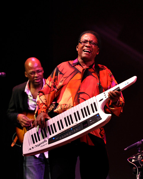 MONTEREY, CA-SEPTEMBER 17: Herbie Hancock performs at the Monterey Jazz Festival in Monterey, CA on September 17, 2011. (L-R): Lionel Loueke, Herbie Hancock. (Photo by Clayton Call/Redferns)
